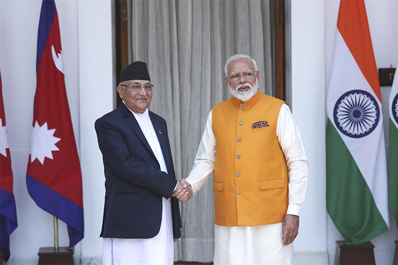 Indian Prime Minister Narendra Modi (right) shakes hands with his Nepali counterpart KP Sharma Oli in New Delhi, India, on Friday, May 31, 2019. Photo: AP