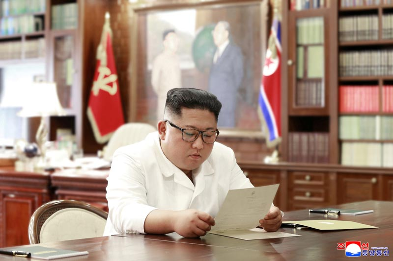 North Korean leader Kim Jong Un reads a letter from US President Donald Trump, in Pyongyang, North Korea in this picture released by North Korea's Korean Central News Agency (KCNA) on June 22, 2019. Photo: KCNA via Reuters
