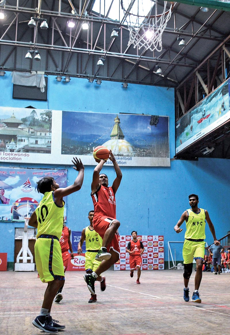 Action in the match between Nepal Police Club (yellow jersey) and Golden Gate International Club during the Kwiks National Basketball League playoffs in Kathmandu on Sunday. Photo: THT
