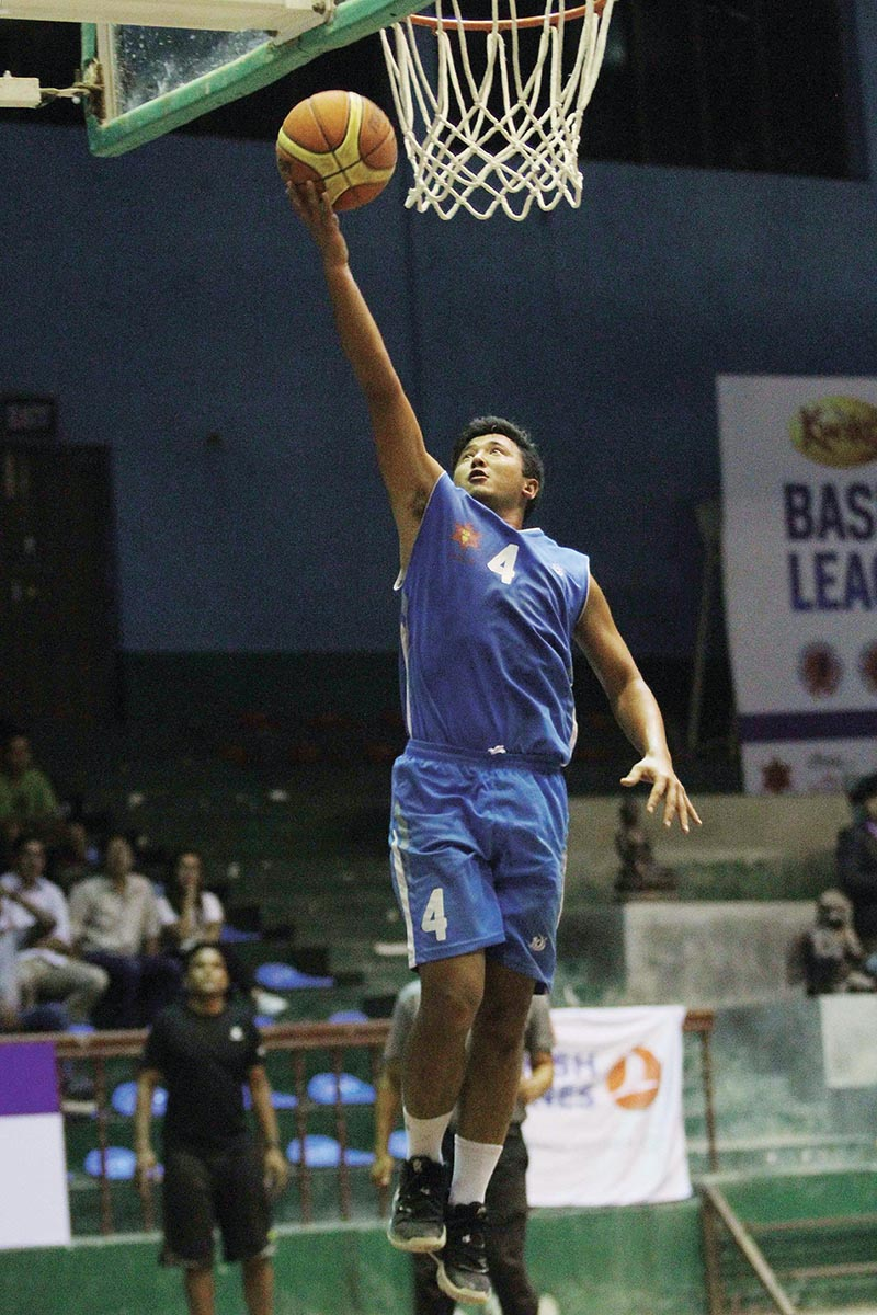 TACu2019s Ayush Singh jumps for a basket against Times International Club during their Kwiks Nepal Basketball League match at the NSC covered hall in Kathmandu on Tuesday. Photo: Udipt Singh Chhetry / THTu00a0