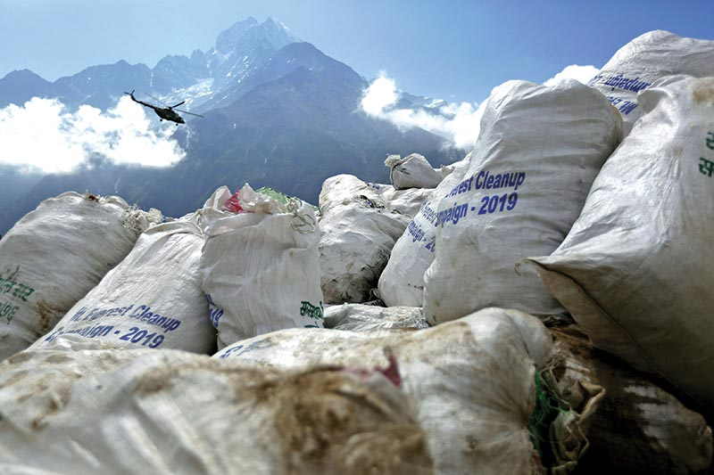 File - Sacks of garbage collected from Mount Everest are seen in Namche Bajar, Solukhumbu district, on May 27, 2019. Photo: AP