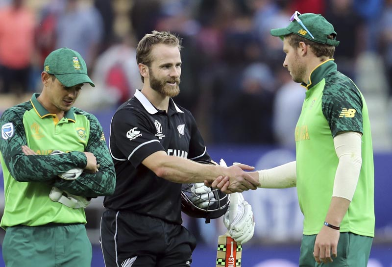 New Zealand's captain Kane Williamson, second from right, shakes and with South Africa's David Miller, right, as teammate Quinton de Kock looks down at end of the Cricket World Cup match between New Zealand and South Africa at the Edgbaston Stadium in Birmingham, Wednesday, June 19, 2019. Photo: AP