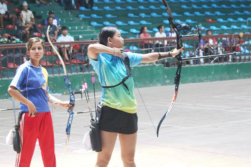 Ashna Lama from The Best Archery prepares for a shot during the Laxman Kumar Shrestha Memorial sixth National Archery Tournament in Kathmandu on Friday, June 28, 2019. Photo: THT