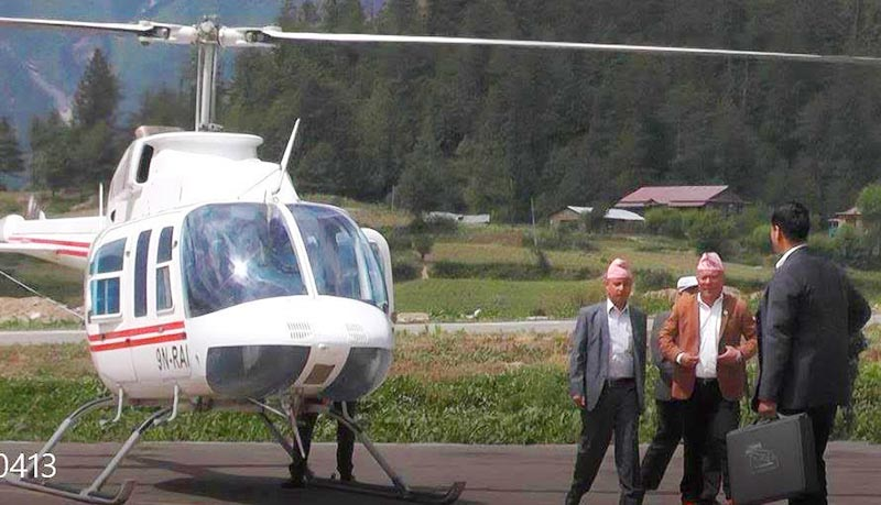 Chief Minister Mahendra Bahadur Shahi of Karnali Province along with other NCP leaders using a Nepali Army chopper to attend a party function, at Humla airport, on Monday, June 24, 2019. Photo: THT