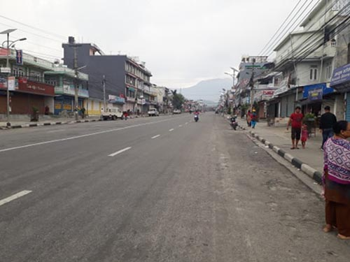 A motorbike is seen on the road and people walking along the footpath in New Road, Pokhara Metropolis-8, on Tuesday, June 25, 2019. Pokhara has largely been affected by the 'Bandh' called by Netra Bikram Chand-led Communist Party of Nepal today as roads and streets have deserted looks with only a few vehicles plying the roads. Photo: Rishi Ram Baral/THT