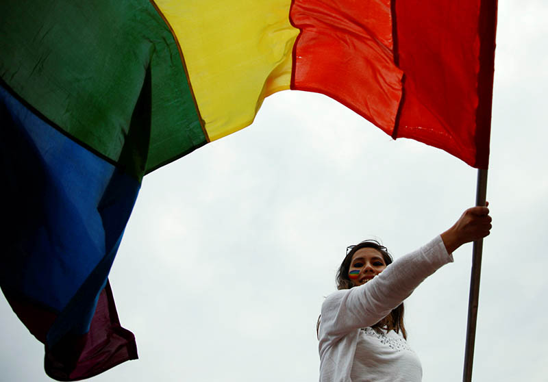 FILE - A participant waves a rainbow flag while taking part in a Gay Pride parade to mark pride month in Kathmandu, Nepal, June 29, 2019. Photo: Reuters