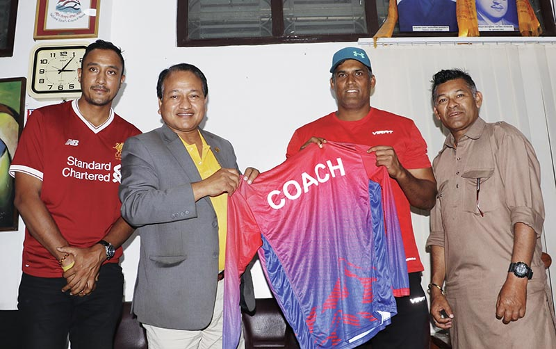 NSC Member Secretary Keshab Kumar Bista handing over jersey to new coach of Nepal national cricket team Umesh Patwal (right) in Kathmandu on Saturday. Photo: THT