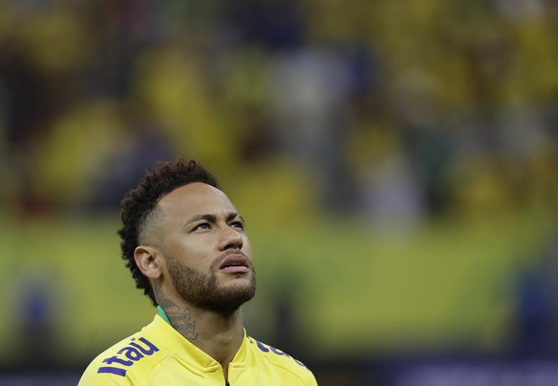 Brazil's Neymar sings the national anthem prior a friendly soccer match against Qatar at the Estadio Nacional in Brasilia, Brazil, Wednesday, June 5, 2019. Photo: AP