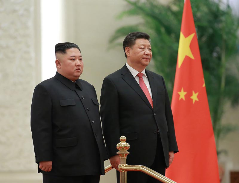 FILE - In this January 8, 2019, file photo provided by the North Korean government, North Korean leader Kim Jong Un (left) and Chinese President Xi Jinping attend a welcome ceremony at the Great Hall of the People in Beijing. Photo: Korean Central News Agency/Korea News Service via AP
