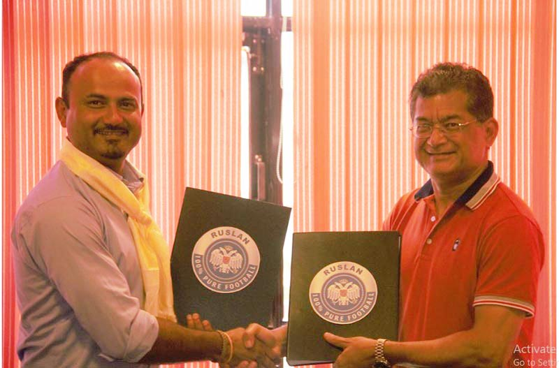 Executive Director of Jawalakhel Group of Industries Sashin Joshi exchanging the MoU with NSJF President Durga Nath Subedi in Lalitpur on Friday, June 7, 2019. Photo: THT