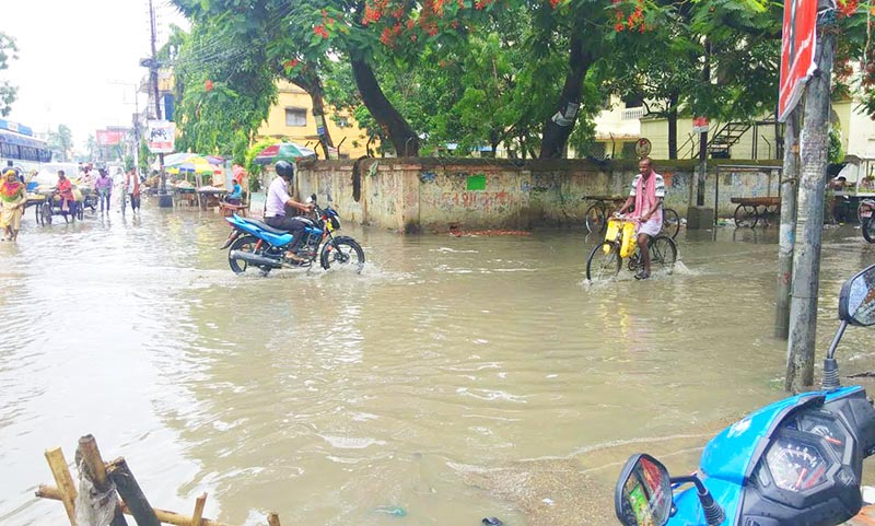 File - Locals crossing an inundated road at Mainroad area of Rajbiraj Municipality, Saptari, on Monday, June 10, 2019. Rainfall that occurred for two hours submerged most parts of the municipality. Photo: Byas Shankar Upadhyaya/THT