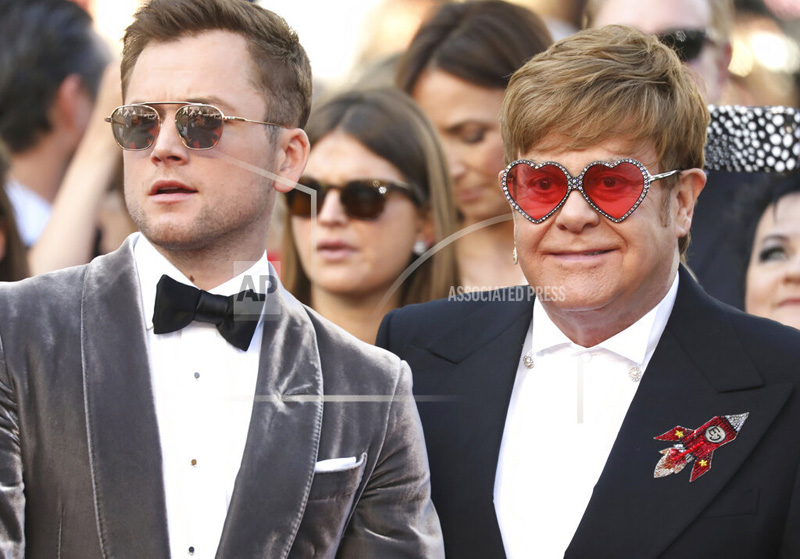 Actor Taron Egerton, left, and singer Elton John pose for photographers upon arrival at the premiere of the film 'Rocketman' at the 72nd international film festival, Cannes, southern France, Thursday, May 16, 2019. Photo: AP