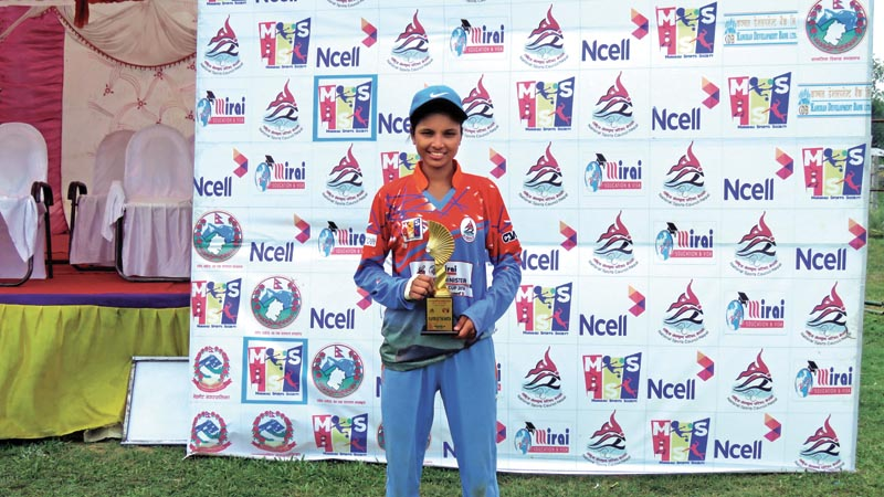 Kabita kunwar of Farwest holds the player-of-the-match award after the Mirai PM Cup match against Province-5 in Mahendranagar on Sunday.Photo: AFP
