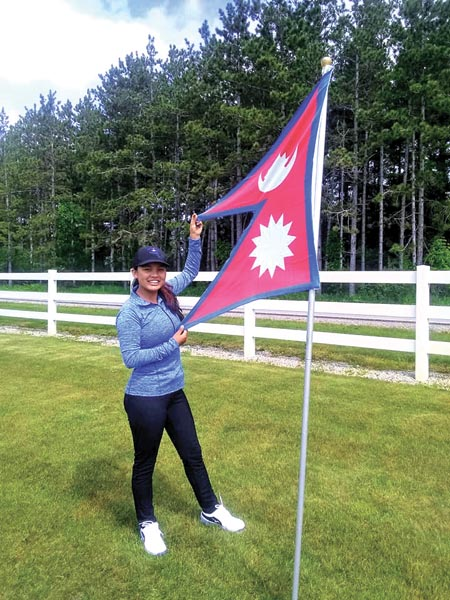 Nepali golfer Pratima Sherpa poses with the national flag after the second round of the Island Resort Championship in Michigan on Sunday. Photo Courtesy: Symetra Tour