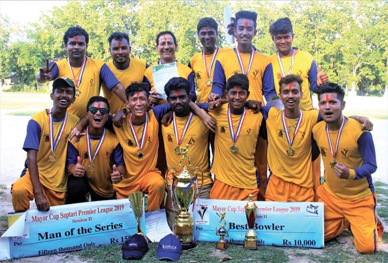 Dakneshwari Dragon team members celebrate with the trophy after winning the Mayor Cup Saptari Premier League in Rajbiraj on Sunday.Photo: Byas Shankar Upadhyay/THT