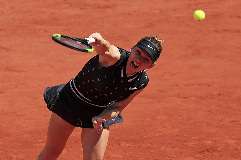 Romania's Simona Halep in action during her third round match against Ukraine's Lesia Tsurenko during the French Open, at  Roland Garros, in Paris, France, on June 1, 2019. Photo: Reuters