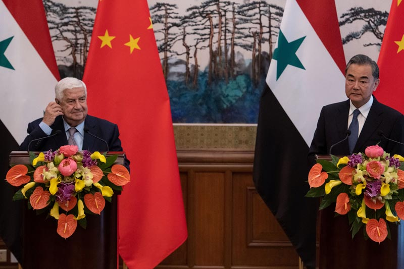 Syrian Foreign Minister Walid Muallem (L) and Chinese Foreign Minister Wang Yi (R) speaks to journalists after a meeting at Diaoyutai state guesthouse in Beijing on June 18, 2019. Photo: Fred Dufour/Pool via Reuters