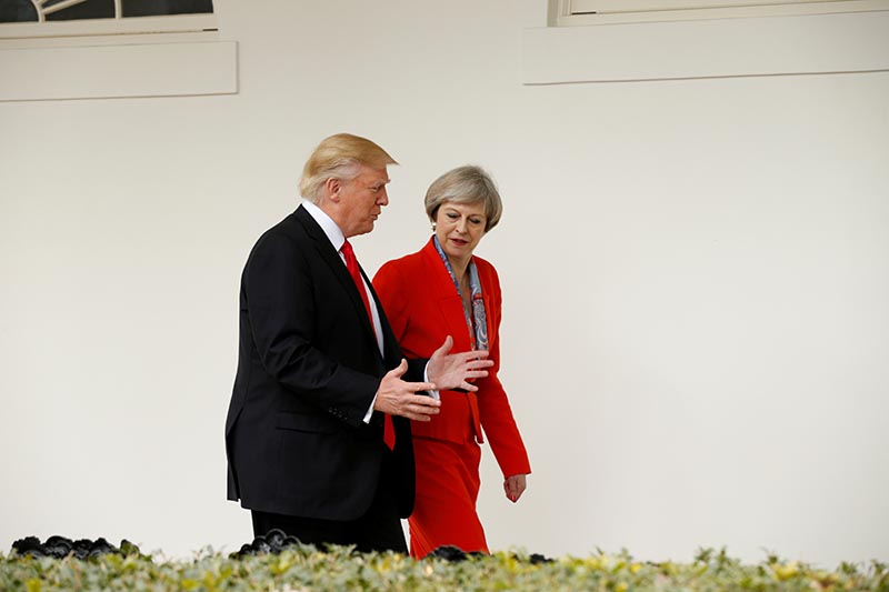 US President Donald Trump escorts British Prime Minister Theresa May after their meeting at the White House in Washington, US, January 27, 2017.   Photo: Reuters /File