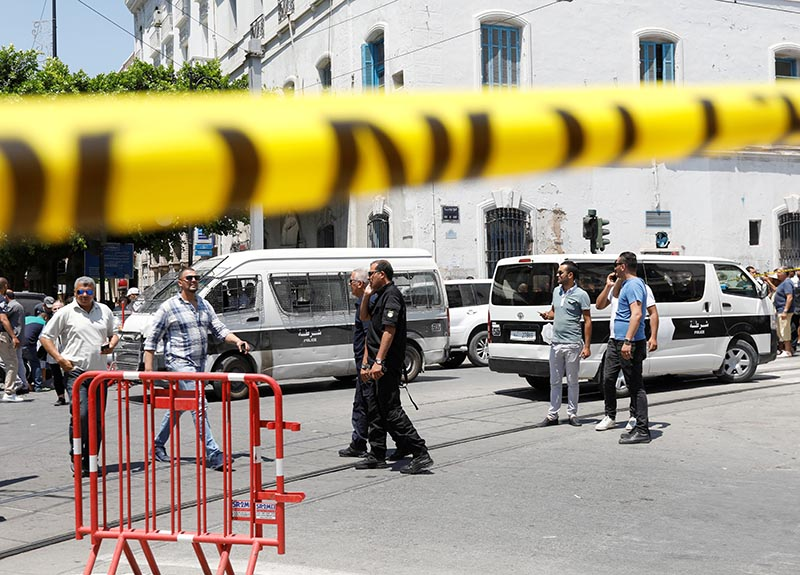 Police officers are seen at the site of an explosion in downtown Tunis, Tunisia, June 27, 2019. Photo: Reuters