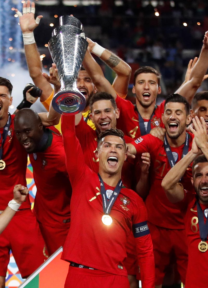 Portugal's Cristiano Ronaldo and team mates celebrate winning the UEFA Nations League Final with the trophy, at Estadio do Dragao, in Porto, Portugal, on June 9, 2019. Photo: Action Images via Reuters