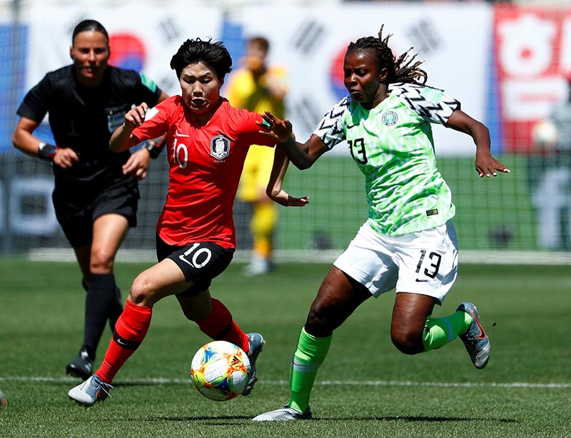 Korea Republic's Ji Soyun in action with Nigeria's Ngozi Okobi during the Women's World Cup Group A match bewteen Nigeria and Korea Republic, at Stade des Alpes, in Grenoble, France, on June 12, 2019. Photo: Reuters