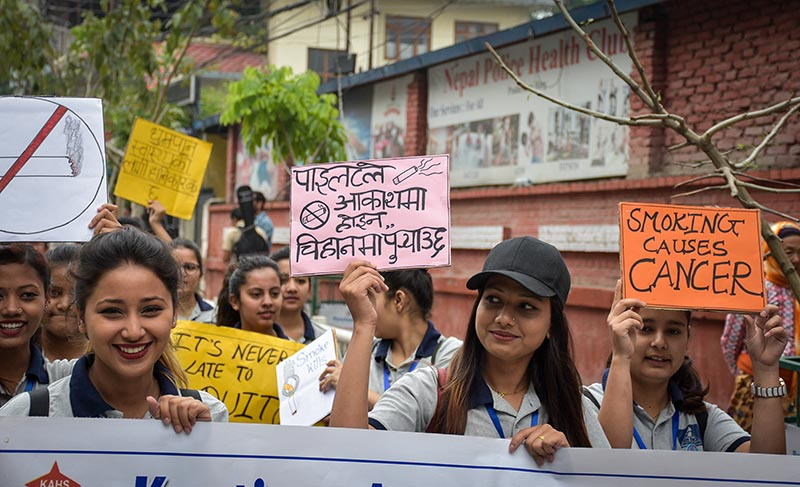 Students taking part in a mass rally holding placards to mark the World No Tobacco Day, in Kathmandu, on Friday, May 31, 2019. Photo: Naresh Shrestha