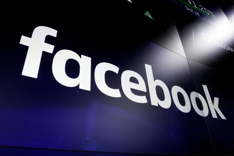 FILE: In this March 29, 2018, file photo, the logo for social media giant Facebook, appears on screens at the Nasdaq MarketSite, in New York's Times Square. Facebook on Tuesday, June 11, 2019, launched an app that will pay users to share information with the social media giant about which apps they're using. Photo: AP/file