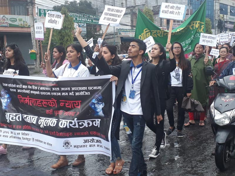 People carry placards and chant slogans in a protest rally demanding justice for Nirmala Panta, end of violence against women, end of other kinds of violence such as murder, in Pokhara, on Thursday, June 6, 2019. The rally -- organised by the Metropolitan Child Forum, Pokhara -- started from Chipledhunga and ended at Prithvi Chok after passing through New Road and Sabha Griha Chok. Photo: Rishi Ram Baral/THT