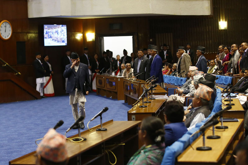 Prime Minister KP Sharma Oli greeting fellow lawmakers while walking to the rostrum to deliver a speech on the Guthi Bill at the House of  nRepresentatives, in Kathmandu, on Tuesday, June 18, 2019. Photo: Skanda Gautam /THT