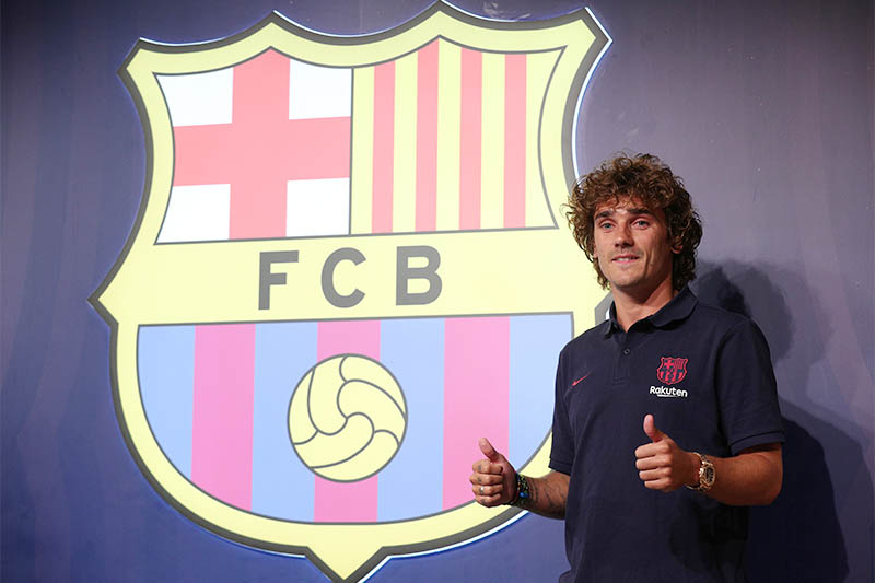 Barcelona's Antoine Griezmann poses for a photo during the press conference. Photo: Reuters