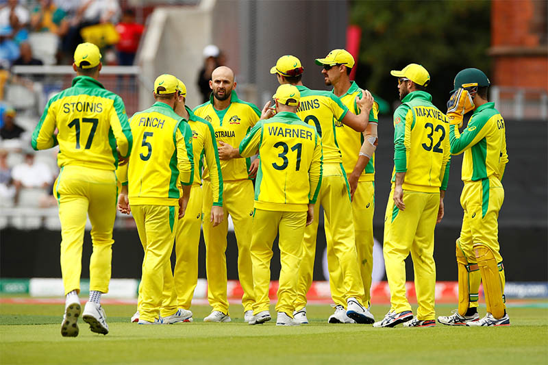 Australia's Nathan Lyon celebrates with Mitchell Starc and team mates after taking a wicket. Photo: Reuters
