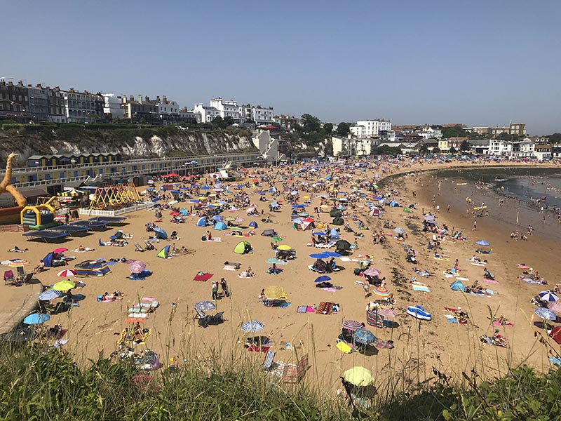 People flock to Broadstairs beach in Kent, England, Thursday July 25, 2019. Photo: Wesley Johnson/PA via AP
