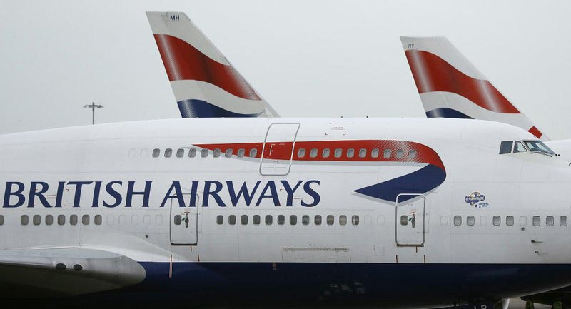 FILe - In this file photo dated Tuesday, Jan. 10, 2017, British Airways planes are parked at Heathrow Airport in London. ???????? The U.K. data regulator, the Information Commissioner's Office said Monday July 8, 2019, it is fining British Airways 183 million pounds (dollars 229 million US) over a breach that compromised information on half a million customers. Photo: AP