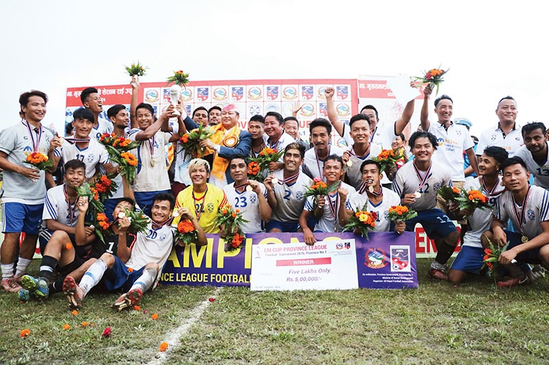 Army Youth Club players and officials celebrate after winning the Chief Minister Cup Province League Football Tournament at the Dharan Stadium on Tuesday. Photo: THT