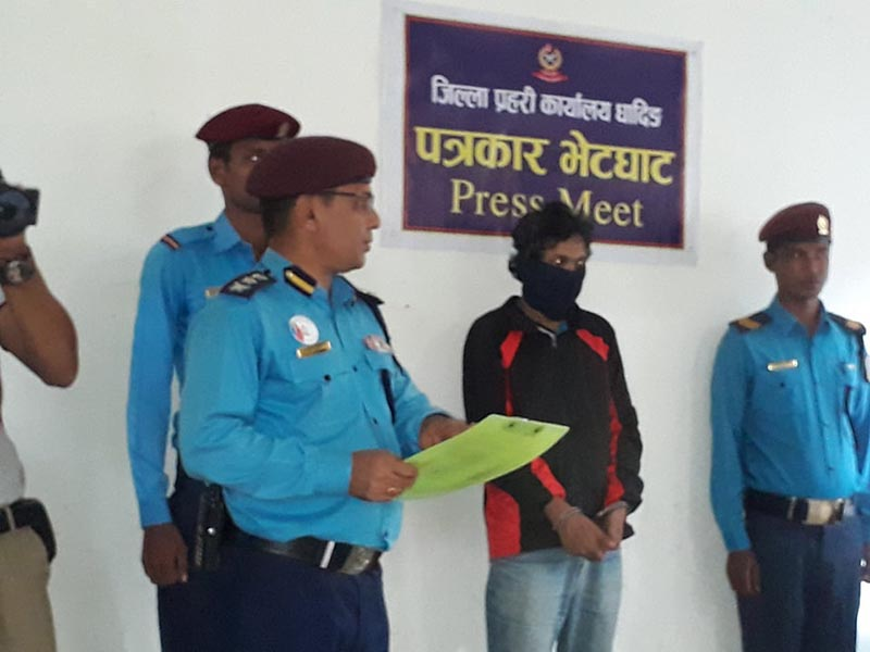 Chief at the District Police Office, Superintendent of Police (SP) Raj Kumar Baidwar makes public an absconding murderer arrested after 17 years, at a press conference held at the DPO, in Dhading, on Tuesday, July 16, 2019. Photo: Keshav Adhikari/THT