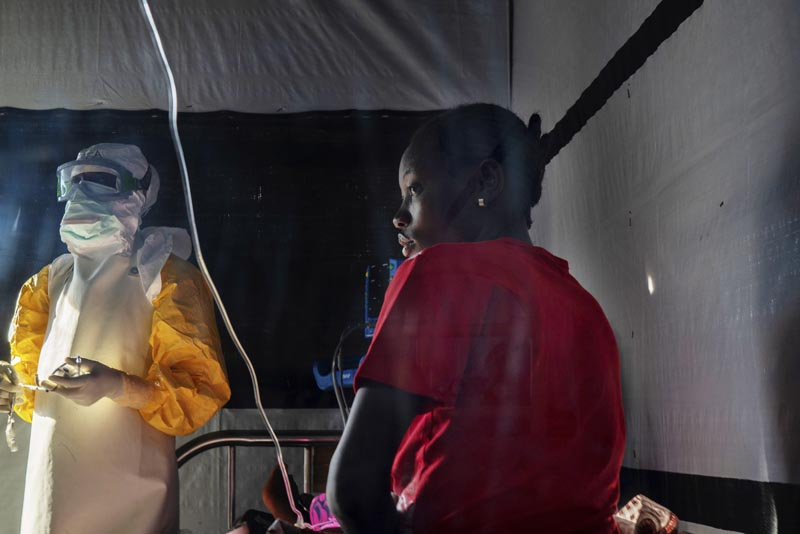 In this Saturday, July 13, 2019 photo, health workers dressed in protective gear check on Ivette Adania (24) a mother of four whose husband died of Ebola, at a treatment center in Beni, Congo. Photo: AP