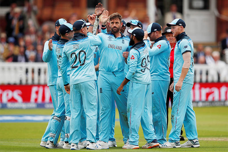 England's Liam Plunkett celebrates taking the wicket of New Zealand's Kane Williamson with team mates. Photo: Reuters