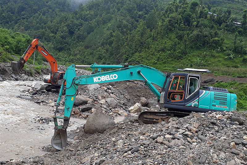 Skyvators being used for extraction of sand and other items from river in Dhading district, on Wednesday, July 31, 2019. Photo: Keshav Adhikari/THT