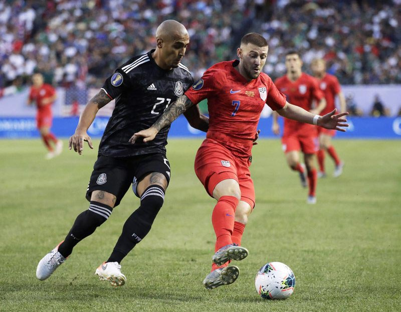 United States forward Paul Arriola, right, controls the ball against Mexico defender Luis Rodriguez during the first half of the CONCACAF Gold Cup final soccer match at Soldier Field in Chicago, Sunday, July 7, 2019. Photo: AP