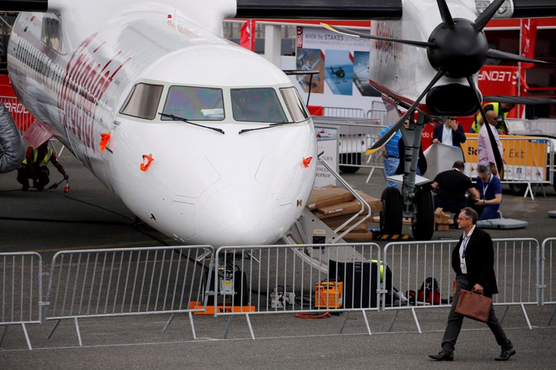 A man walks past an Bombardier Q400 of Indian airline SpiceJet on static display, at the eve of the opening of the 53rd International Paris Air Show at Le Bourget Airport near Paris, France, June 16 2019. Photo: Reuters/File