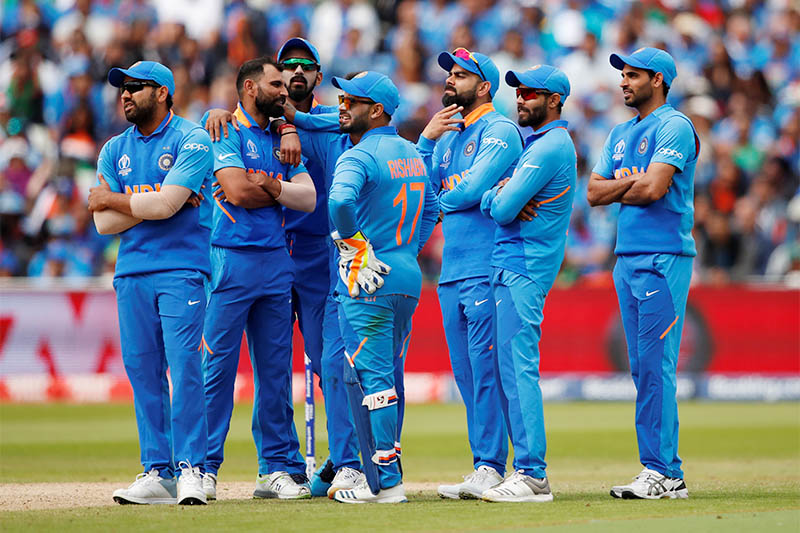 India's Virat Kohli and team mates await the outcome of a review. Photo: Reuters
