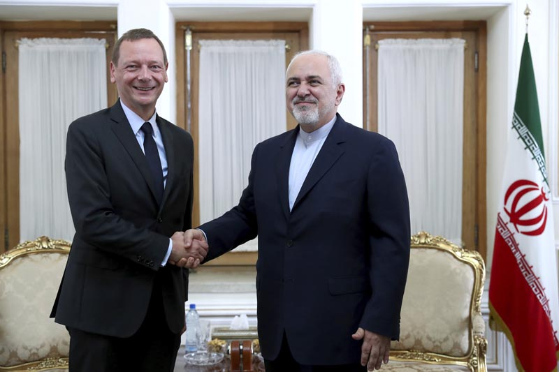 Iranian Foreign Minister Mohammad Javad Zarif (right) shakes hand with French presidential envoy Emmanuel Bonne, as they pose for photos, in Tehran, Iran, Wednesday, July 10, 2019. Photo: AP