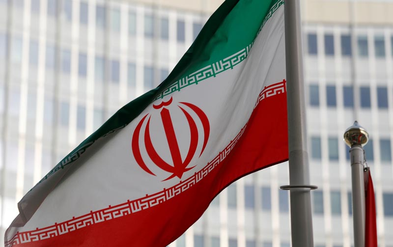 FILE: The Iranian flag flutters in front the International Atomic Energy Agency (IAEA) headquarters in Vienna, Austria March 4, 2019. Photo: Reuters