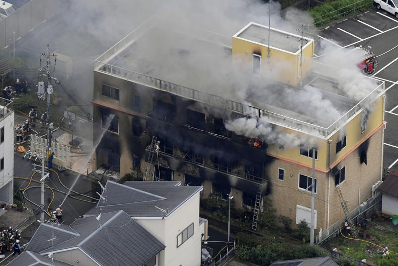 Smoke billows from a three-story building of Kyoto Animation in a fire in Kyoto, western Japan, Thursday, July 18, 2019. Photo: Kyodo News via AP