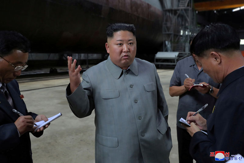 North Korean leader Kim Jong Un visits a submarine factory in an undisclosed location, North Korea, in this undated picture released by North Korea's Central News Agency (KCNA) on July 23, 2019. Photo: KCNA via Reuters