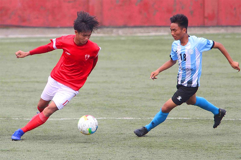 Players of Brigade Boys Club (left) and Manang Marshyangdi Club vie for the ball during their Lalit Memorial U-18 Football Championship semi-final match at the ANFA Complex grounds in Lalitpur on Thursday, July 18, 2019. Photo: THT