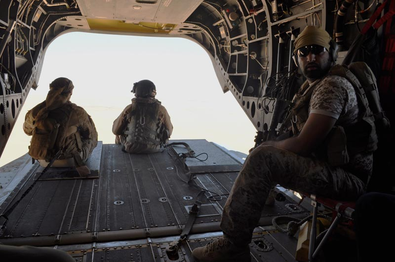 FILE - In this September 14, 2015, file photo, Emirati soldiers stand guard out the rear gate of a Chinook military helicopter traveling from Saudi Arabia to Yemen. Photo: AP