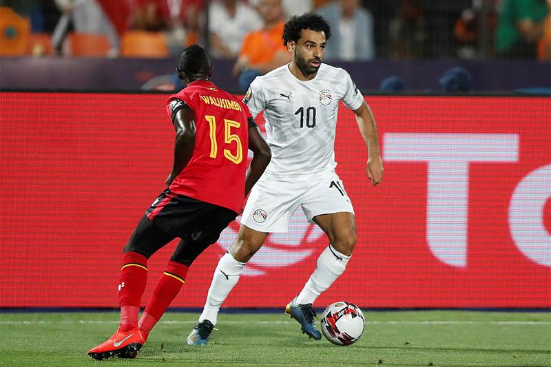 Egypt's Mohamed Salah in action with Uganda's Godfrey Walusimbi. Photo: Reuters