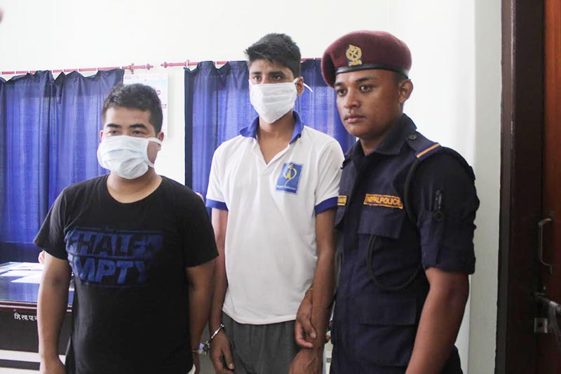Police making two rape accused public at Rangeli Area Police Office, Morang, on Sunday, July 28, 2019. Photo: THT