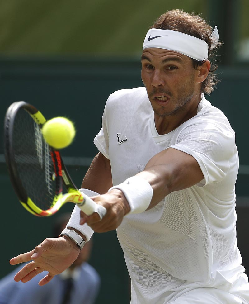 Spain's Rafael Nadal returns to Portugal's Joao Sousa in a Men's singles match during day seven of the Wimbledon Tennis Championships in London, Monday, July 8, 2019. Photo: AP